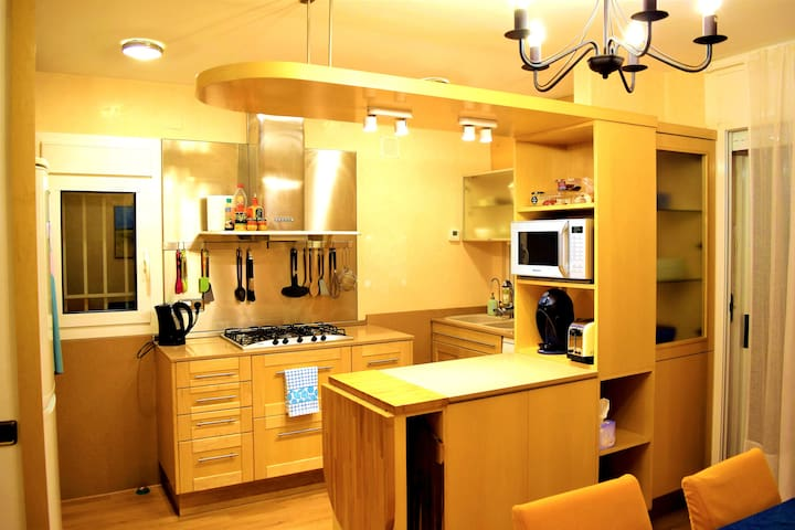 Kitchen has stove with five burners including large paella burner, high-capacity vent hood, light, and utensils rack.  Two windows face south and east to private gardens.  Dishwasher.  Coffee maker.  Toaster.  Microwave. Electric kettle.