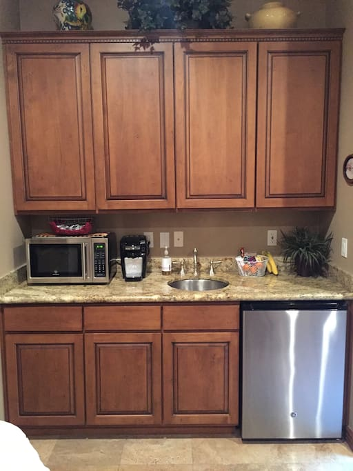 Kitchenette with refrigerator, microwave, Keurig, and toaster oven