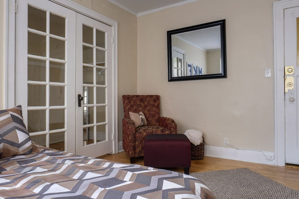 Queen size bed and chair for reading or watching TV