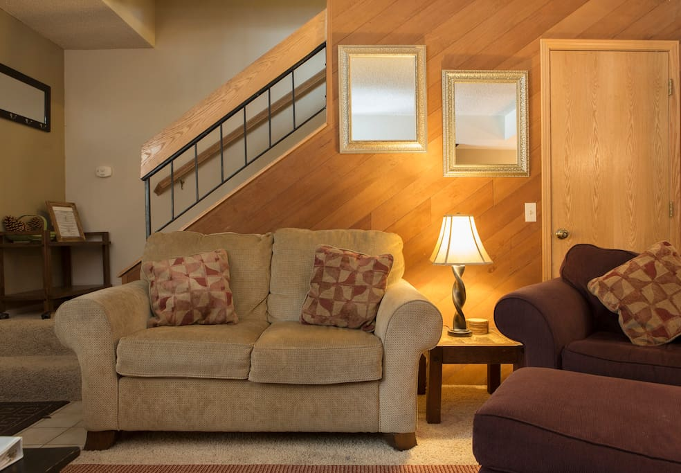 Love seat and stairs to the second floor