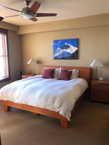 Master bedroom, kind sized bed with en suite bathroom