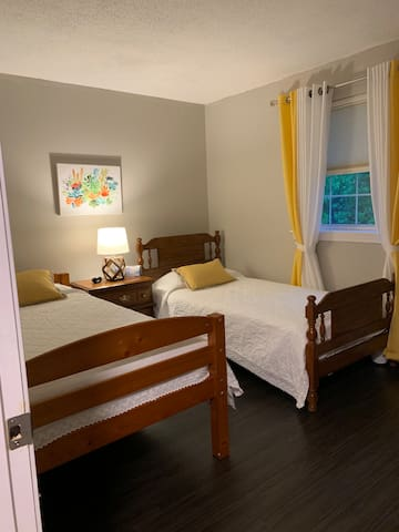 2nd bedroom - two twin beds and window.