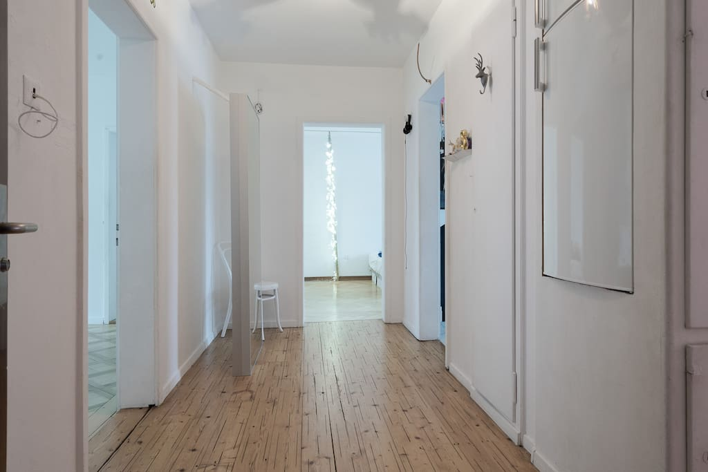 White space. Wooden floor. To enjoy maximum space (for you and me) - there is minimum of furniture around.