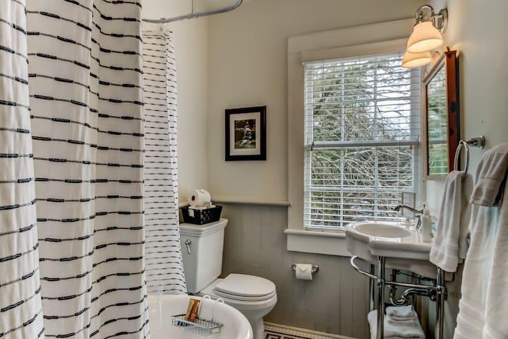 Full bathroom upstairs with clawfoot tub.