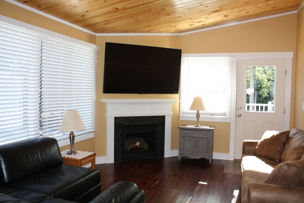 The living area features a 70 inch HDTV, propane fireplace with granite surround, Italian leather sectional and a queen pull out sleeper sofa.