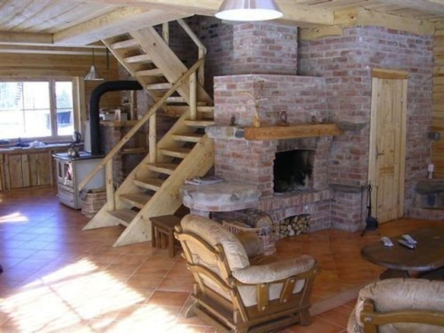 The interior is all natural, providing the combination of comfort and nature. You can enjoy the warmth from the fireplace as well as scenery of the forest from the panoramic windows.