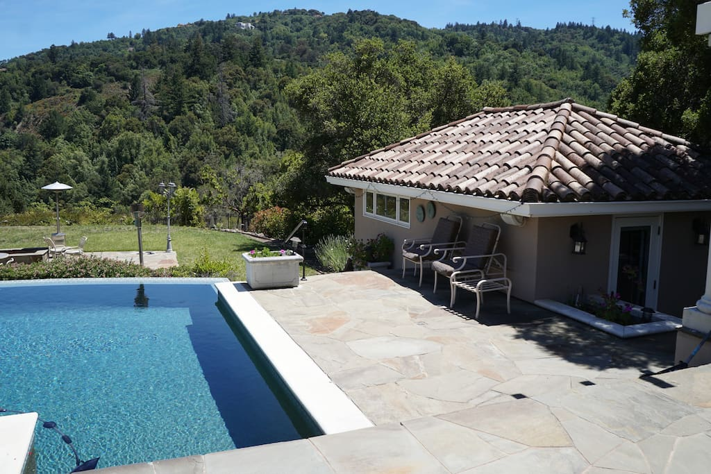 The private Studio Guest House is next to the pool.