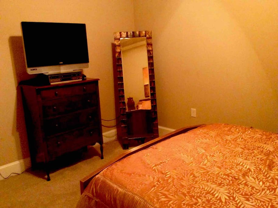This room comes with a nice big flat screen TV ,2 large dressers a full sized mirror, closet and small cooler for drinks.
