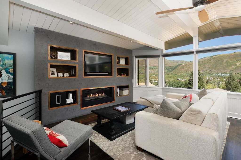 Wall to wall windows in the living space showcase the beautiful Aspen scenery.  Soak this up in front of the gas fireplace and flat screen TV.