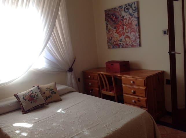 2nd bedroom with en suite shower with window onto garden