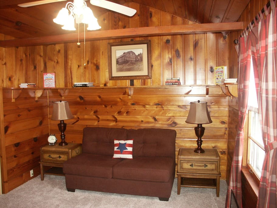 Relax in comfort in the den which attains a cabin-in-the-woods feeling.
