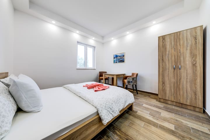 Bedroom has king size bed and wardrobe for your stuffs.