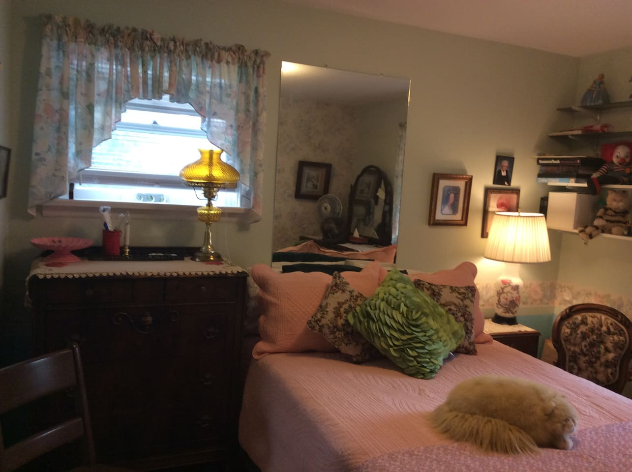 The double bed with antique dresser. Windows have room darkening blinds.   Bathroom is adjacent to the bedroom.