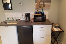Your kitchenette includes a full sink, refrigerator, microwave, coffee pot, plates, bowls, silverware, coffee and everything you need to chill and reheat your leftovers from any of the local fabulous restaurants, drinks and reheating food.