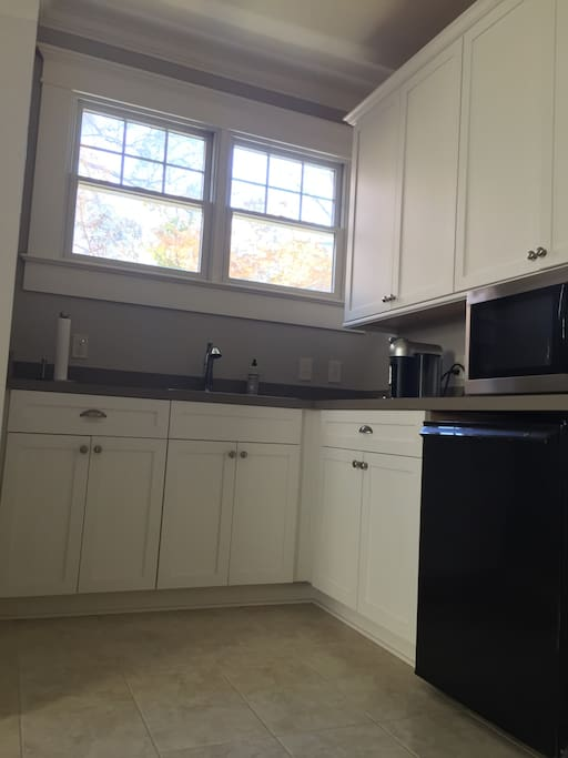 Kitchenette with microwave, refrigerator, and Nespresso machine