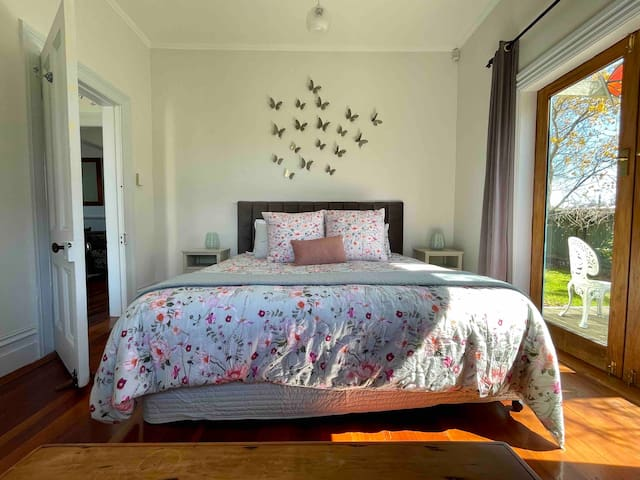 Butterfly bedroom with super king bed and French doors to deck