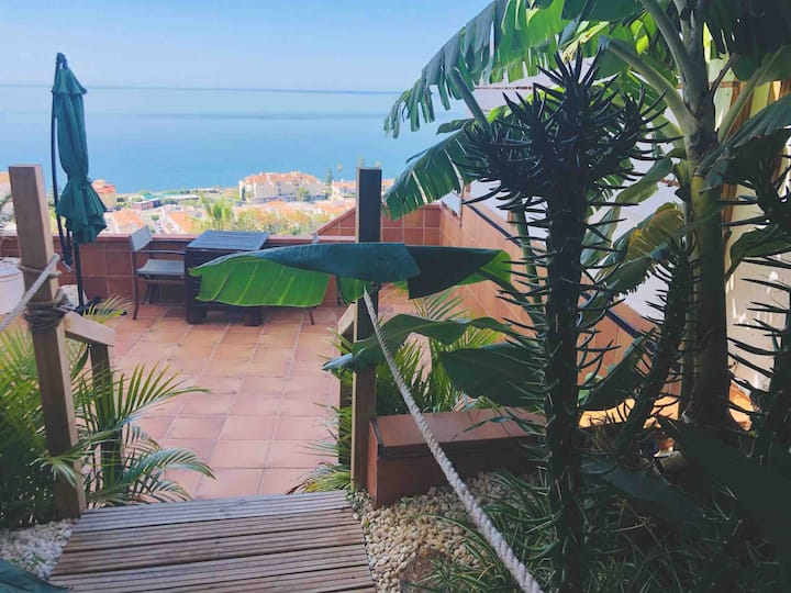 Panoramic Sea Views from a Private Garden Oasis