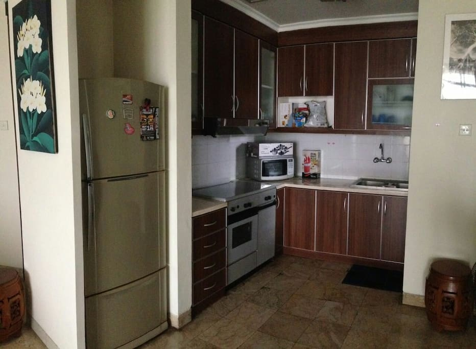 Fully equipped spacious kitchen (3 doors refrigerator, microwave, stove & oven, water dispenser, and rice cooker.