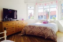 Large front bedroom, king size and single bed.