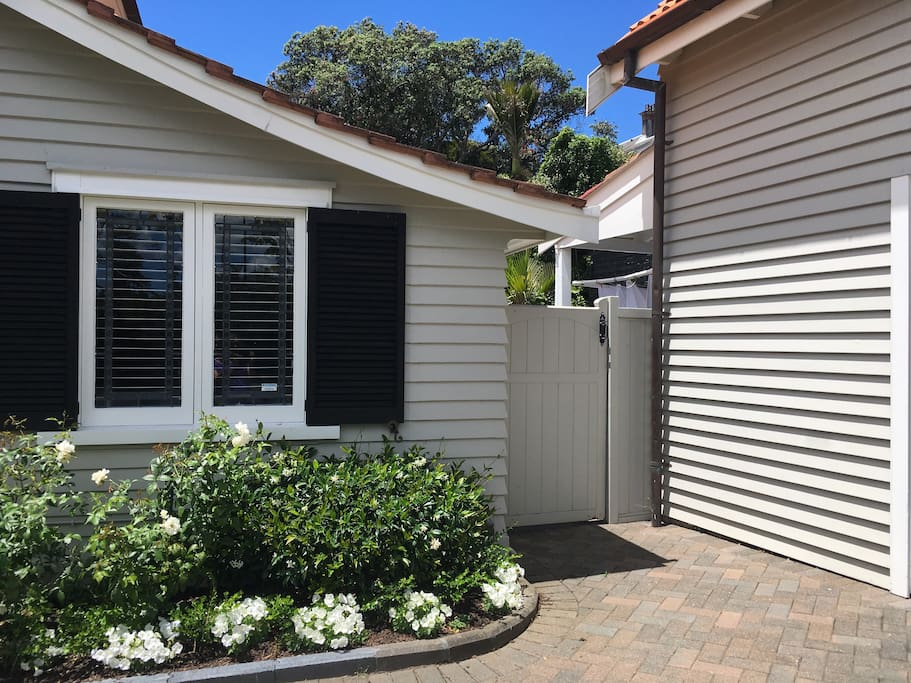 Walk through the gate between house and garage and turn right to find access to studio.