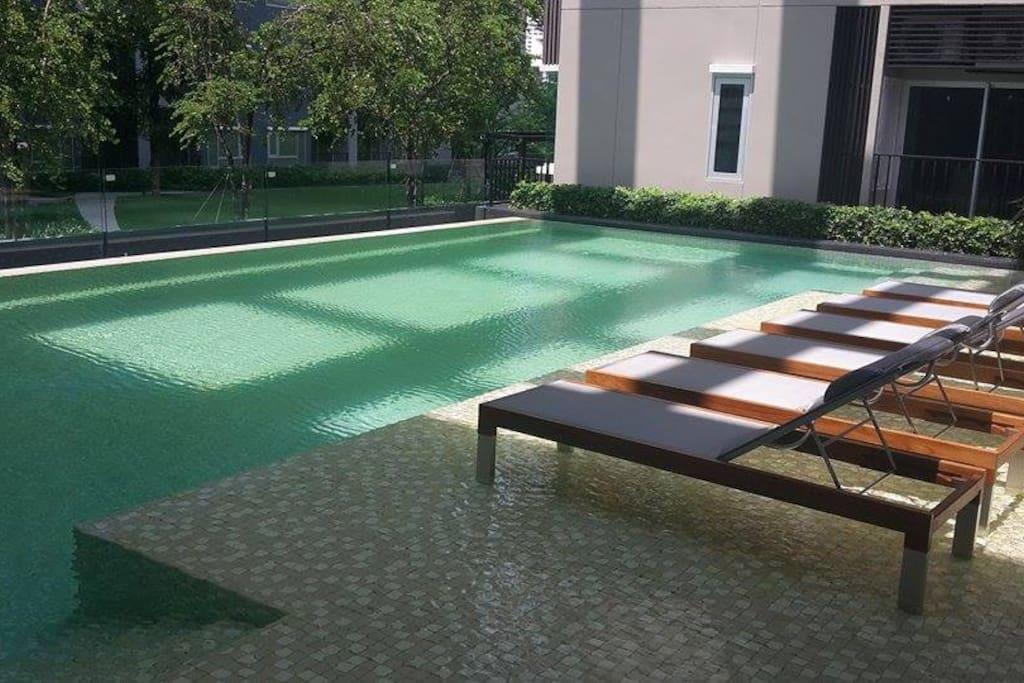 Swimming pool very close to the room.