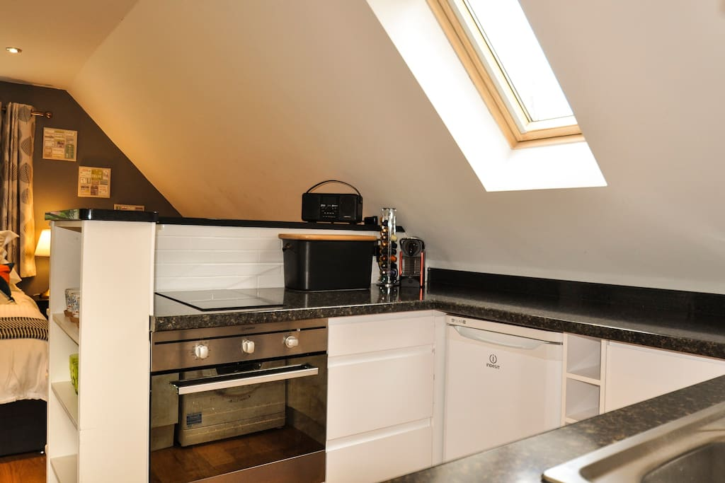 Kitchen with Nespresso machine and complimentary pods