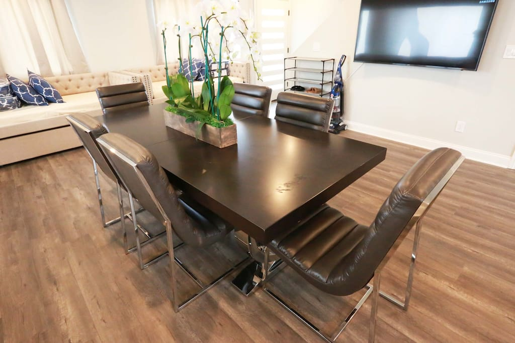 Dining area: large dining table with 6 leather executive chairs. Great for meetings as well as dining.
