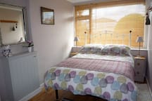 Double bed with easy access both sides, bedside lights and bedside rugs