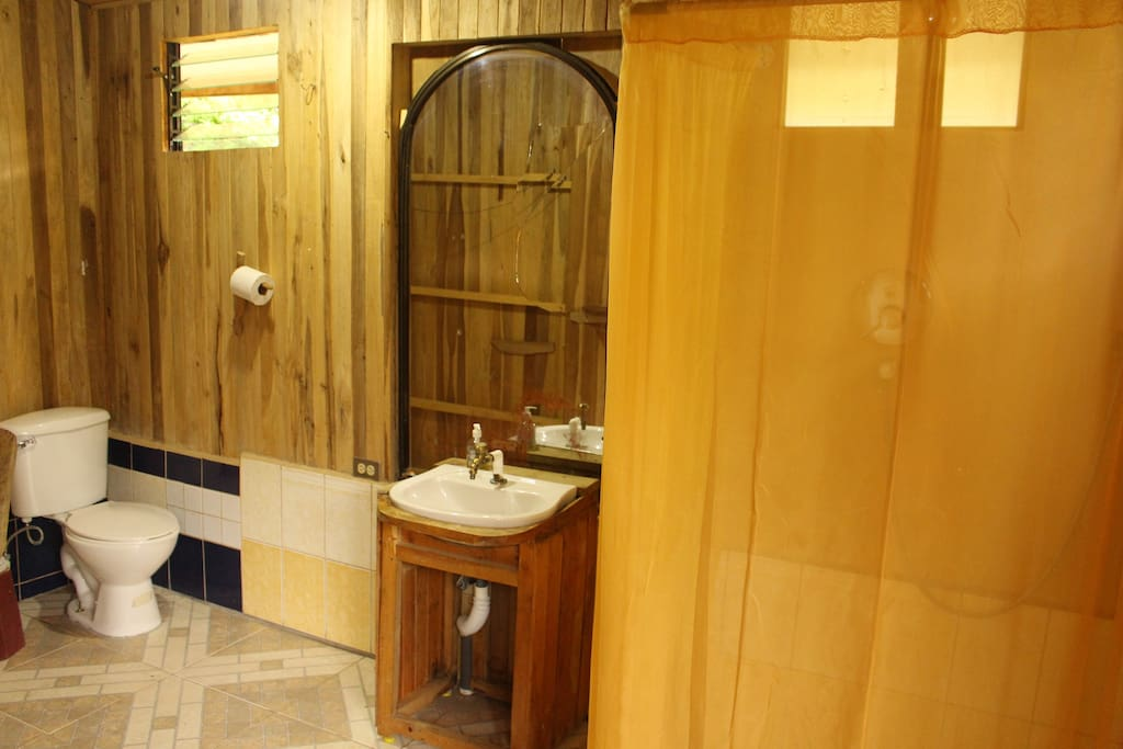 Spacious bathroom with hot shower