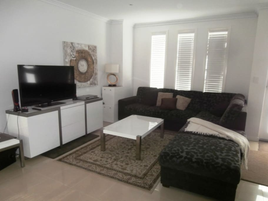 "Comfortable modern lounge with 48"" LCD TV & Great Sound system with DVD Player"