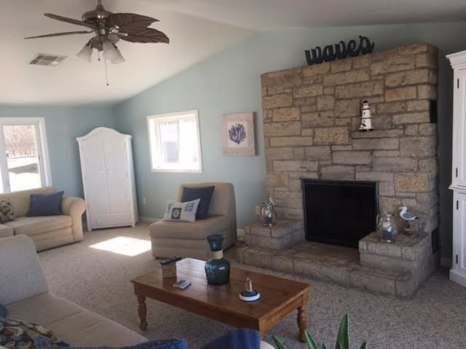 Great room with vaulted ceiling and fireplace