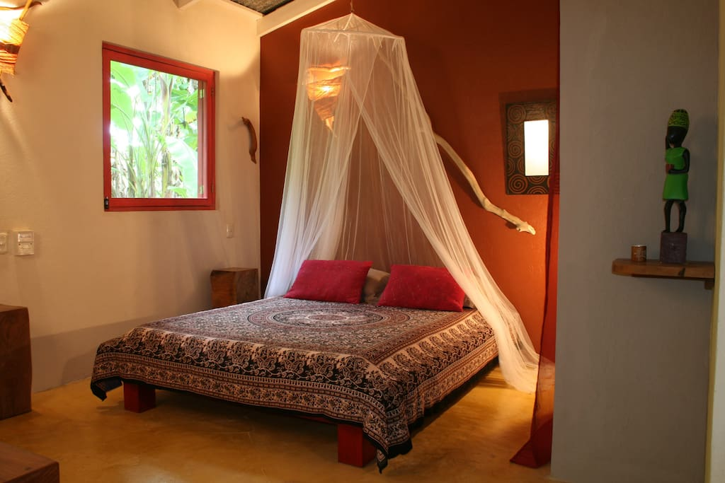 Queen bed with netting more for the tropical appearance than a necessity.