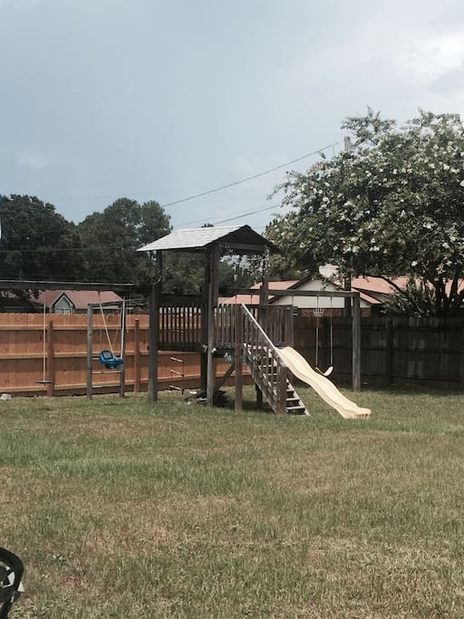 Playground located next to guest house in the backyard