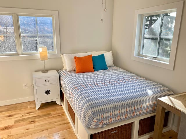 Guest BR. Queen size bed.  Tons of light, but blackout shades offer privacy and darkness if you prefer to sleep in.