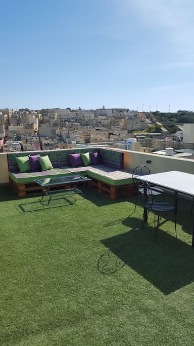 roof terrace with seating and bbq