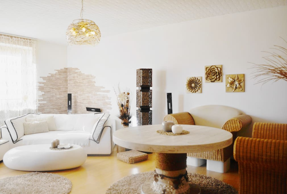 The bright living room is furnished with warm colors and its design creates a southern flair.