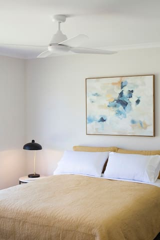 Lovely wall art throughout the home with lamps in each bedroom