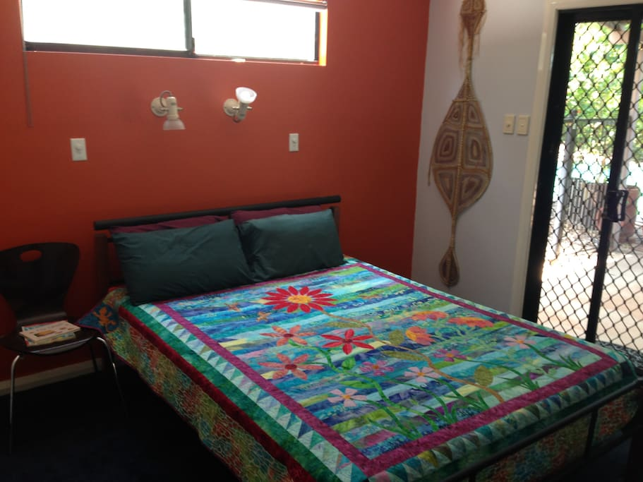 Comfortable Queen Size bed, with direct access to outdoor pool area.