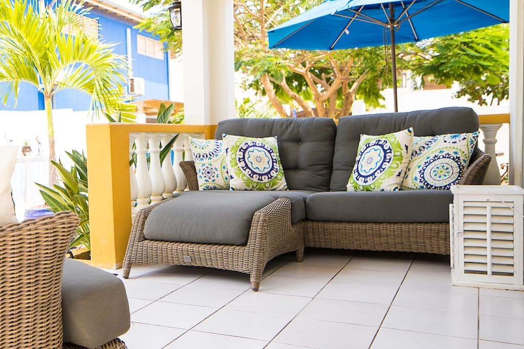 Covered patio provides shade so you can relax comfortably outside.