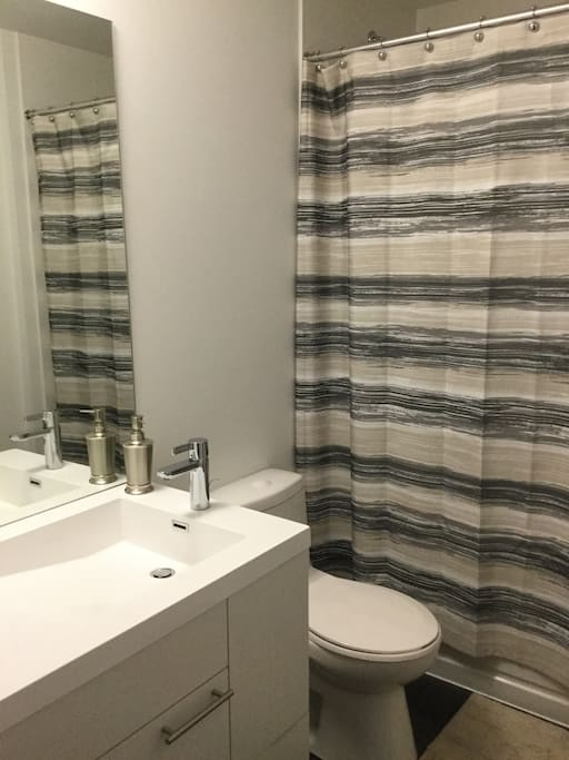 Spacious and connecting to the bedroom, this bathroom has everything you need with style