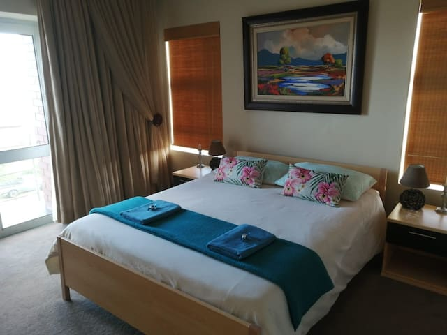 Bedroom 3 with sea views and private balcony.