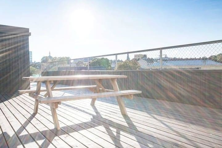 Shared roof top space. Excellent for sun and view