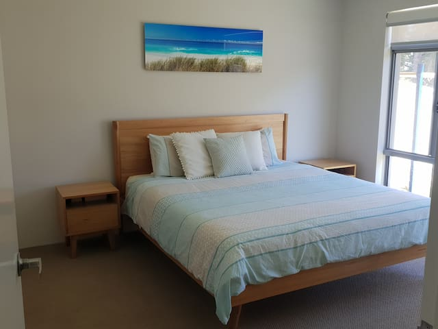 Comfortable king sized bed in master