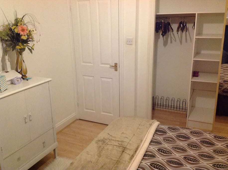 Wardrobe space and floor to ceiling mirror