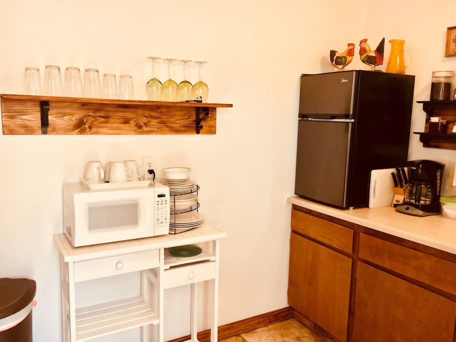Kitchenette has all the basics, mini fridge, microwave, coffee maker with supplies, kitchen sink, dishes, cutlery etc.