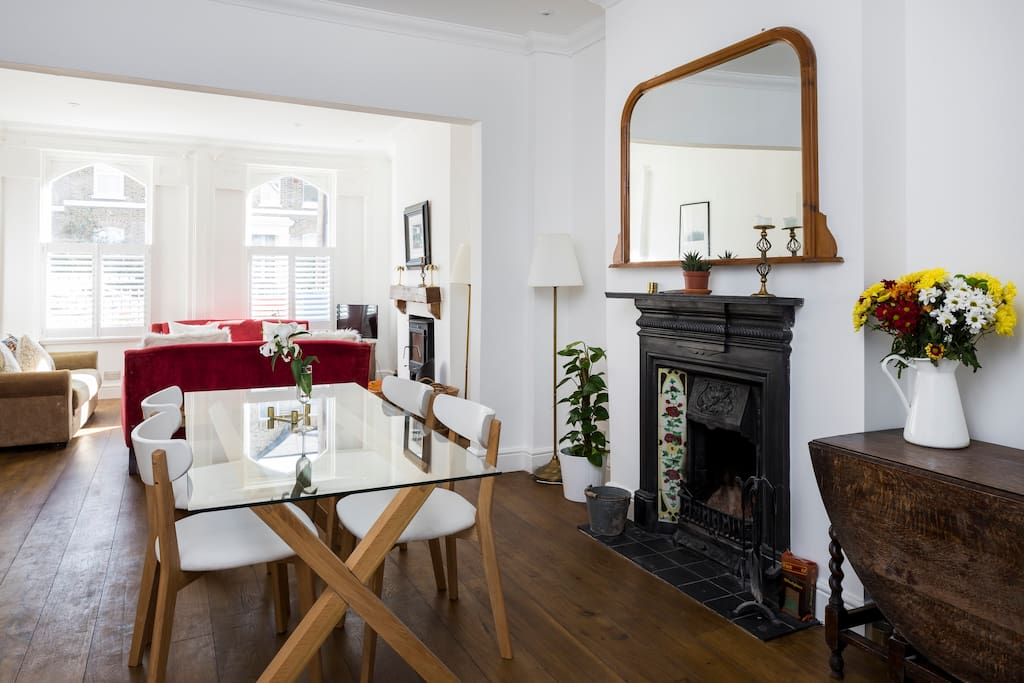 It is an open-plan space with a dining table at one end of the room.