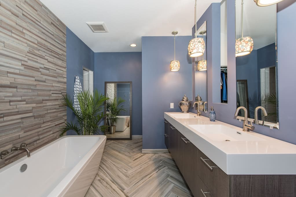 Luxurious master bath suite adjoins master bedroom with separate shower and tub, double sinks.