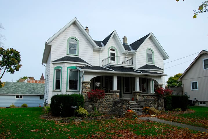 Our home is complete with original bay windows, stone porch and a balcony.