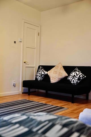 Have another guest? Please use this couch as another bed for their stay.