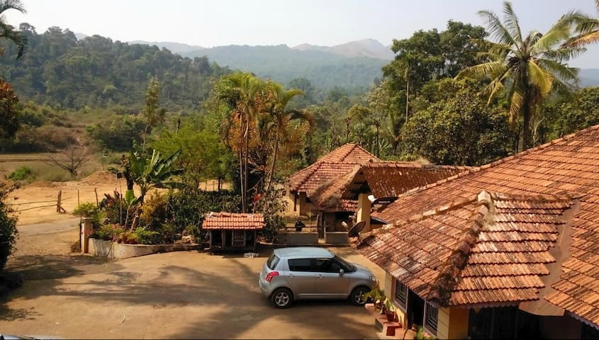 Suman's riverside Estate (coorg naladi holidays)